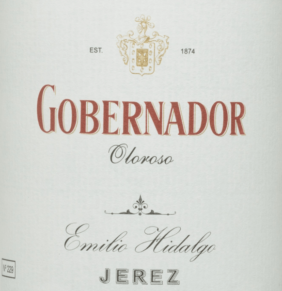 The Gobernador Oloroso by Emilio Hidalgo is a sherry from the Spanish wine region D.O. Jerez, aged for many years. A bright mahogany colour shines in the glass. This noble sherry convinces the nose as well as the palate with its strong nutty aromas - walnuts, hazelnuts and almonds. On the palate, this Spanish wine convinces with its full-bodied and dry character and a long-lasting reverberation. Vinification of HidalgoGobernador Oloroso The grapes harvested by hand are destemmed, gently pressed and the must produced therefrom fermented in a temperature-controlled manner in a stainless steel tank. The young wine is then drawn off, sprayed on and placed in American oak barrels for the first ripening. The barrels are filled only to a certain extent (maximum 85%), so that the characteristic pile (a yeast layer) can develop, which seals the wine airtight and gives it the sherry-specific aroma. After maturation, the wine is transferred to the traditional Solera system, in which sherries of the same type are aged in barrels arranged one above the other. The oldest wines are stored in the lower barrels (Solera), while the youngest wines are stored in the upper rows (Criaderas). The sherry intended for sale is always removed from the lower barrels. In this case, however, only a small part (a maximum of one third) is removed and the removed part is then filled up by sherry from the upper rows. The whole principle continues to the uppermost barrels, where young wine, the Mosto, is added to the sherry. In the Solera, the amontillado loses its pile and the oxidative ripening process begins. During this phase, it develops its aromatic fullness and strong color. Food recommendation for Gobernador Oloroso Emilio Hidalgo This dry sherry from Spain goes best chilled as an aperitif. But this wine is also a treat for spicy, refined meat dishes.