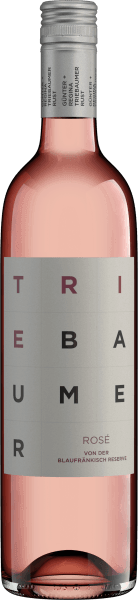 """The clear, bright, strong colour of Blaufränkisch Rosé from Triebaumer is reminiscent of fresh raspberries. Aromas of fresh banana, juicy peach, rose hips and raspberries determine the bouquet. A hint of fresh mint fills the nose. At optimal ripeness nuances of juicy Mieze-Schindler strawberries can be heard An elegant melt with a dancing fruit sweetness flatters the palate. The semi-dry taste of the Blaufränkisch Rosé from Triebaumer is supported by a stimulating fruit acid. In addition to fine plums and mirabelle plums, fresh pears can also be tasted. The lively style of this wonderful Rosé from Austria and the solid volume with enchanting finesse accompany the finish. Vinification of the Triebaumer Rosé This rosé from Triebaumer is produced at the end of September in six batches from the grapes for the Blaufränkisch Reserve. After selective manual harvest and maceration, the must is drawn off after 3 hours and then fermented in steel tanks in a chilled state. Fermentation is finally interrupted by drawing off and cooling, so that the rosé retains a natural residual sugar content. Recommended with the Triebaumer Blaufränkisch Rosé Enjoy this light rosé from the classic Blaufränkisch grape variety as a well-chilled aperitif or with sheep's cheese with dried tomato chutney, beetroot soup, spinach ravioli, various salmon dishes or with pheasant with cranberries and pink pepper. The Triebaumers themselves say about their rosé: """"It is also consumed privately by numerous men. It's not without reason that for four years now they've also been serving festival wine in Bregenz."""""""
