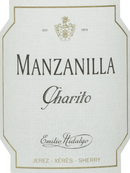 Emilio Hidalgo's Charito Manzanilla is a refreshing, dry sherry from the Polomino Fino grape variety (100%) In the glass, this wine shines in a bright straw yellow with glittering reflections. The nose enjoys fragrant notes of yellow stone fruits and nuts. On the palate, this sherry is light and elegant with a long reverberation.  Vinification  of Emilio Hidalgo Charito Manzanilla The grapes harvested by hand are destemmed, gently pressed and the must produced therefrom is fermented in a temperature-controlled manner in a stainless steel tank. This young wine is then drawn off, sprayed on and placed in American oak barrels for the first ripening. The barrels are filled only to a certain extent (maximum 85%), so that the characteristic pile (a yeast layer) can develop, which seals the wine airtight and gives it the sherry-specific aroma. After maturation, this wine is transferred to the traditional Solera system, in which sherries of the same type are aged in barrels arranged one above the other for three to ten years. The oldest wines are stored in the lower barrels (Solera), while the youngest wines are stored in the upper rows (Criaderas). The sherry intended for sale is always removed from the lower barrels. In this case, however, only a small part (a maximum of one third) is removed and the removed part is then filled up by sherry from the upper rows. The whole principle continues to the uppermost barrels, where young wine, the Mosto, is added to the sherry. Food recommendation for  the Manzanilla Charito by Emilio Hidalgo This dry sherry from Spain tastes best chilled and goes well with tapas, fish and seafood as an aperitif.