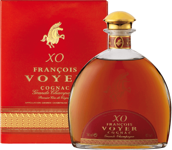 The XO François Voyer Gold Cognac Grande Champagne by François Voyer captivates with a ruby-brown colour and mahogany reflections. The exceptional brandy seduces with intense floral notes that dominate wood and spice tones. The long storage in oak barrels gives it harmony and the characteristic of an excellent old cognac.  Elegant and sophisticated in all dimensions, it boasts an abundance of flavours such as vanilla, dried fruits, ginger and walnuts. They mix with subtle hints of pepper, spices and wood. The woody taste is enhanced by hints of dried fruits and vanilla in the long-lasting and complex finish. Serving recommendation for the XO François Voyer Gold Cognac Grande Champagne by François Voyer Enjoy it undiluted or with ice cubes, after which it could warm up in the glass for 10 minutes.