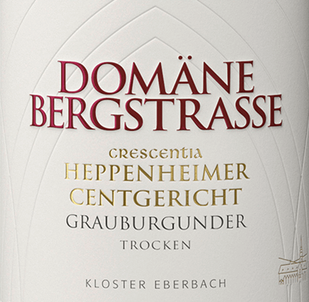 The Heppenheimer Centgericht Grauburgunder Crescentia from Domäne Bergstraße is a fascinating white wine from a VDP first vineyard of the German Rheingau wine region. In the glass this wine shimmers in a tender yellow tone with golden highlights. The quite cool bouquet reveals aromas of citrus fruits with green pomaceous fruit - like Granny Smith apples - and nutty as well as mineral nuances. On the palate, this German white wine presents a delicate and discreet sweetness. Nutty and filigree salty nuances follow, which perfectly surround the present acid structure. The finish is wonderfully long and is accompanied by a citric touch. Vinification of the Crescentia Domäne Bergstraße Heppenheimer Centgericht Grauburgunder The Heppenheimer Centgericht Lage is a southwest-facing slope and belongs to the Bergsträsser monopoly of the Hessische Staatsweingüter Kloster Eberbach. After the grapes have been carefully harvested and destemmed in the winery, the grapes are gently pressed. After pressing, the juice is separated from the berry skins and the grape seeds. With this white wine the alcoholic fermentation takes place to 20% in high-grade steel tanks and to 80% in oak wood barrels (1200 litres and 2400 litres). After the biological degradation of acidity, this wine is stored on the fine yeast until bottling. Food recommendation for the Eberbach Domäne Bergstraße Grauburgunder Heppenheimer Centgericht Crescentia Enjoy this dry white wine from Germany with classic Flammkuchen or vegetable tarts. But also to Tafelspitz with Frankfurter green sauce this wine is a pleasure.
