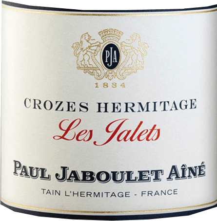 At the sight of the Les Jalets Rouge Crozes Hermitage by Domaine Paul Jaboulet Aîné, a beautiful, glossy ruby red colour with violet highlights appears. The aromatic bouquet is reminiscent of red, sour wild berries with a final spicy note. The palate with the full prelude looks well balanced and gentle, with depth, beautiful fullness and fine liquorice notes in the finish. Food recommendationfor Les Jalets Rouge by Domaine Paul Jaboulet Aîné This red wine cuvée is a wonderful treat with juicy grilled entrecote with green pepper, lamb ragout with braised shallots or casserole in a dough coat.