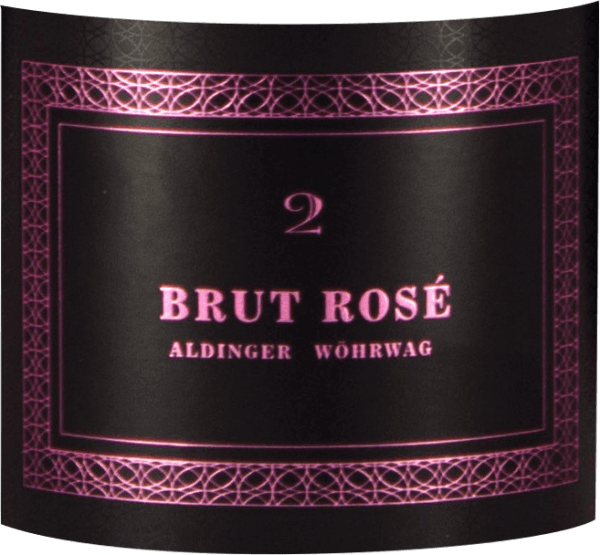 The Brut Rosé 2 sparkling wine from Aldinger & Wöhrwag comes into the glass with light pink and immediately reveals a fine, elegant perlage that inspires at least as much in addition to the impressive bottle. The nose of this Württemberg winemaker's sparkling wine is determined by a delicate rose scent, which is accompanied by hints of elderberry and spicy sea buckthorn berries. Fragrant nuances of quinces, oranges and kumquats round off the bouquet of Aldinger and Wöhrwag Brut Rosé 2 together with fine yeast pastry notes. On the palate, the Brut Rosé 2 is extremely elegant and at the same time impressive. An exceptional rosé sparkling wine that can compete with many champagnes for 3-4 times the price. Vinification of Brut Rosé 2 sparkling wine from Aldinger & Wöhrwag This sparkling wine from various Burgundy grapes is the joint project of the Aldinger and Wöhrwag wineries from the Stuttgart region. Both VDP wineries decided that such a venture requires maximum expertise and they logically found it at Volker Raumland, the undisputed champagne champion of Germany. In 2006, two years after the first Pinot brood, it was time. The first brood of rosé saw the light of the wine world. The base wine for this top rose sparkling wine is vinified exclusively in a stainless steel tank. The second fermentation logically takes place in the bottle. Aldingers and Wöhrwags Brut Rosé 2 then matures on the yeast for two whole years before the bottles are degorged and corked. Food recommendations for the brood Rosé 2 by Aldinger and Wöhrwag Serve this exclusive German wine sparkling wine as an aperitif with Norway lobster on avocado apple tartar or with light canapés.