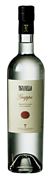 Marchesi Antinori's Grappa Tignanello is crystal clear, with the typical aromas of Sangiovese and Cabernet grapes on the nose, soft, warm and fruity on the palate, with a long and pleasant finish. Production of the Grappa Tignanello by Marchesi Antinori This fine and aromatic grappa is distilled from the pomace of the grapes harvested from the Tignanello vineyard for the homonymous wine. The fermented pomace is immediately taken to the distillery after the wine has been removed from the vats and the grapes have been pressed accordingly. Only the highest quality pomace is used, rich in alcohol and especially aromatic ingredients. From the grappa distilled from the various batches of marc, only the best, finest and most aromatic distillates are married and bottled as Grappa Tignanello. Grappa Tignanello is available in limited quantities. Serving suggestions for the Grappa Tignanello by Marchesi Antinori Enjoy this fine Tignanello Grappa as a digestif after a nice meal, at Christmas or on a special occasion, possibly even as a crowning finale after a meal that was accompanied with Tignanello.