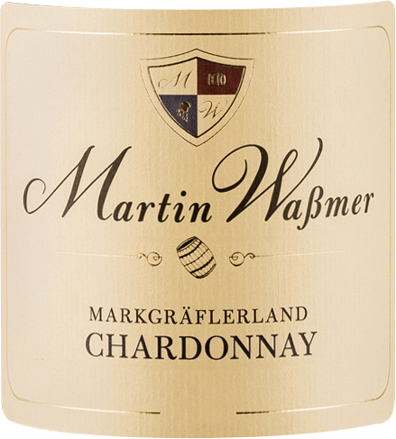 The barrel-aged Markgräflerland Chardonnay SW from the Baden wine-growing region presents itself in the glass in a bright golden yellow. When swirling the wine glass, this white wine from Martin Waßmer reveals aromas of vineyard peach, peaches, quince, apples and pears, complemented by beech smoke, dark chocolate and firewood This German wine delights with its elegantly dry flavors. It was bottled with only 2.3 grams of residual sugar. This is a real quality wine, which clearly stands out from simpler qualities and so this German wine enchants naturally with all dryness with the finest balance. Aroma does not necessarily need residual sugar. Due to its vital fruit acid, the Markgräflerland Chardonnay SW is impressively fresh and lively on the palate. Vinification of the Martin Waßmer Markgräflerland Chardonnay SW The balanced Markgräflerland Chardonnay SW from Germany is a single-varietal wine, vinified from the Chardonnay grape variety. In Baden, the vines that produce the grapes for this wine grow on soils of clay, limestone and loess. The Markgräflerland Chardonnay SW is an Old World wine in the best sense of the word, as this German wine breathes an extraordinary European charm that clearly underscores the success of Old World wines. Moreover, the fact that the Chardonnay grapes thrive under the influence of a rather cool climate has a considerable influence on the ripening of the vintage. Among other things, this manifests itself in particularly long and evenly ripened grapes and rather moderate alcohol content in the wine After the harvest, the grapes are quickly taken to the press house. Here they are sorted and carefully broken up. Fermentation then takes place in small wood at controlled temperatures. At the end of fermentation, the Markgräflerland Chardonnay SW is aged for several months in French oak barrels. Food recommendation for the Markgräflerland Chardonnay SW by Martin Waßmer This German wine is best enjoyed moderately chilled at 11 - 13°C. It is p