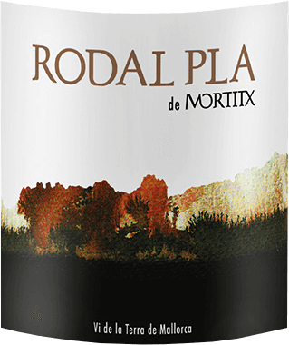 The Rodal Pla de Mortitxby Vinyes Mortixt appears in the glass in a dark red with a complex bouquet that seduces with intense fruity and spicy aromas. These include the notes of sweet cherries, blackberries, as well as pepper and tobacco leaves. This cuvée from the Merlot, Cabernet Sauvignon, Syrah grape varieties is balanced on the palate and fleshy with round tannins and a pleasant spicy finish. Vinification of Mortitx Rodal Pla This top red wine from Majorca was vinified from73% Syrah, 16% Cabernet Sauvignon and 11% Merlot. The grape varieties were mashed separately and fermented for between one and two weeks. The Rodal Pla then matures for 6 months in French oak barriques. Food recommendation for the Mortitx Rodal Pla Enjoy this dry red wine with lamb backs, grilled red meat and cheese. Awards for the Mortitx Rodal Pla Guia Penin: 88 points for 2013
