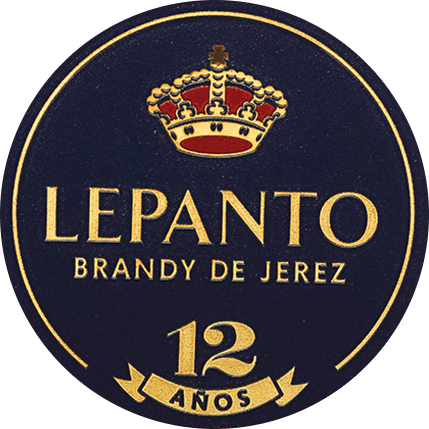 The Lepanto Solera Gran Reserva by Gonzalez Byass from the Spanish wine region DO Jerez is distilled exclusively from the Palomino Fino grape variety. This brandy shines in the glass in a bright topaz with orange-gold shades. The nose reveals an elegant bouquet with fine notes of raisins, nuts, almonds, vanilla and caramel. Its dry, ripe and complex taste reflects the warm spicy aromas of the bouquet and is crowned by a long and velvety aftertaste. Vinification of Byass Solera Gran Serva Lepanto For this brandy, only selected, best Palomino Fino grapes are used and pressed in the wine cellar of Bodega Los Arcos. The fine must is fermented rapidly and then burned twice in copper boilers. The copper burners are two original Alambics Charentais with a volume of 25hl. Only the fine firing with65 to 72 volume percent is used for this brandy and placed inthe Solera and Criadera system for a total of 12 years. These are 600 litres of American oak wooden barrels, which are also used for sherry production. For 9 years this brandy matures informer Tío-Pepe barrels - the remaining 3 years inMatusalem Cream-Sherry barrels. Serving recommendation for the Lepanto Solera Gran Reserva Enjoy this Brandy de Jerez as a nice end to a cozy meal, or with spicy blue cheese. But also pure (gladly also on ice) this brandy is a pleasure.
