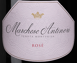 """The Marchese Antinori Rosé Franciacorta DOCG by Tenuta Montenisa by Marchesi Antinori glows delicately onion shell colours in the glass, the fine and sustainable perlage forms an elegant creamy foam edge. On the nose it smells slightly of dried wild flowers, on the palate this Rosé Franciacorta captivates with the perfect balance between freshness and structure, which end in a remarkably harmonious and elegant, long finish. Vinification of the Marchese Antinori Rosé Franciacorta DOCG by Tenuta Montenisa The Rosé Franciacorta belongs to the """"Classici"""" line of the Tenuta Montenisa. For this spumante, only Pinot Noir, which comes from the estate's own vineyards, is vinified. The young must is subjected to alcoholic fermentation in the stainless steel tank, followed by malolactic fermentation in the bottle on the fine yeasts over a period of 24 months. Food recommendations for the Marchese Antinori Rosé Franciacorta DOCG by Tenuta Montenisa Enjoy this harmonious and balanced rosé as an ideal accompaniment to appetizers, shellfish, light meat. Try this beautiful spumante but also with desserts with forest fruits and tender bitter chocolate."""