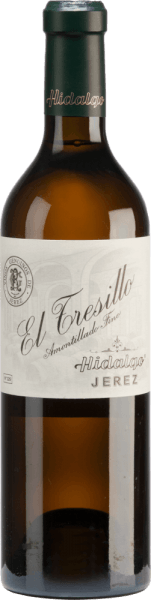 El Tresillo Amontillado by Emilio Hidalgo from the sherry cultivation area D.O. Jerez in Andalusia, is vinified exclusively from Palomino Fino grapes.  A clear mahogany colour with glittering reflections shimmers in the glass of this sherry. The bouquet convinces with its multifaceted aroma - especially hazelnuts, walnuts and almonds are in the foreground and are accompanied by spicy notes. On the palate, this sherry presents itself balanced with a present, full-bodied and body-rich character. Even in the long finale, fine-nosed nuances still show up.  Vinification of Emilio Hidalgo El Tresillo Amontillado The grapes harvested by hand are destemmed, gently pressed and the must produced therefrom is fermented in a temperature-controlled manner in a stainless steel tank. This young wine is then drawn off, sprayed on and placed in American oak barrels for the first ripening. The barrels are filled only to a certain extent (maximum 85%), so that the characteristic pile (a yeast layer) can develop, which seals the wine airtight and gives it the sherry-specific aroma. After maturation, this wine is transferred to the traditional Solera system, in which sherries of the same type are aged in barrels arranged one above the other for three to ten years. The oldest wines are stored in the lower barrels (Solera), while the youngest wines are stored in the upper rows (Criaderas). The sherry intended for sale is always removed from the lower barrels. In this case, however, only a small part (a maximum of one third) is removed and the removed part is then filled up by sherry from the upper rows. The whole principle continues to the uppermost barrels, where young wine, the Mosto, is added to the sherry. Food recommendation for  El Tresillo Hidalgo Amontillado This sherry from Spain goes perfectly with dishes with salted meat or with duck roasts with dumplings and blueberry.  Awards for  El Tresillo Amontillado by Emilio Hidalgo Vinum: 18 points Guía Peñín: 93 points The Wine Advocate: 90 points
