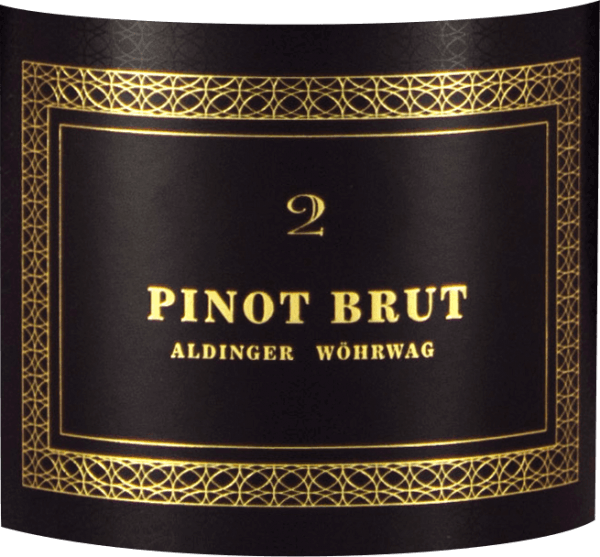 """The Pinot Brut 2 sparkling wine is a joint project of the Aldinger and Wöhrwag wineries, which brought the legendary sparkling wine grape Volker Raumland on board for their grandiose sparkling wine. In the glass comes her Pinot Brut 2 quite as elegant as it already presents itself in the bottle. The color wonderfully straw yellow, the pearl elegant and fine. Delicate pearl strings work from the mousse point in the glass towards the surface and light an extraordinary bouquet, which is carried by the finest yeast notes, ripe as well as pickled pears, dried apricots and white. On the palate, the Pinot Brut 2 by Aldinger and Wöhrwag presents a wonderful full-bodied mouthfeel, without a """"too much"""" of carbonic acid spoiling the fun and forcing us to sip small. With Pinot Brut 2 everything is just right, especially the balance. The autolysis aromas are reminiscent of fresh peasant bread crust and brioche and make some champagne sweat for three times the price. Great! Vinification of Pinot Brut 2 sparkling wine from Aldinger & Wöhrwag This sparkling wine made from white Pinot Noir grapes is the joint project of the Aldinger and Wöhrwag wineries in Stuttgart. Both VDP wineries decided that such a venture requires maximum expertise and they logically found it at Volker Raumland, the undisputed champagne champion of Germany. In 2004 it was time. The first Pinot brood saw the light of the wine world. The base wine for Pinot Brut 2 is vinified exclusively in a stainless steel tank. The second fermentation logically takes place in the bottle. Then Aldingers and Wöhrwags Pinot Brut 2 matures for two whole years on the yeast before the bottles are degorged and corked. Food recommendations for Pinot Brut 2 by Aldinger and Wöhrwag Serve this exclusive German wine sparkling wine solo as an aperitif or with salads with smoked fish, with char lobster or mussels with white wine sauce."""