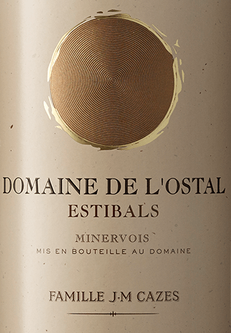 The Domaine L'Ostal Cazes Estibals Minervois AOC by Domaines Cazes is named after one of the best vineyards of the domaine: Estibals. With its deep red color with violet hints in the glass, the L'Ostal Cazes Estibals offers a rich bouquet with aromas of cherries, blackberries and red fruits, as well as fragrances of Mediterranean macchia. On the palate, this red southern French wine is full-bodied and smooth with fine-structured tannins and a touch of oak. Long, round finish. The Domaine L'Ostal Cazes is made from a blend of the youngest vines that do not meet the criteria for the production of the Grand Vin of L'Ostal Cazes. The cuvée consists of 42% Syrah, 36% Carignan, 12% Grenache and 10% Mourvèdre. The wine is aged 12 months in French oak barrels. The balance of different grape varieties provides the best expression of the AOC Minervois. Food pairing for Domaine L'Ostal Cazes Estibals by Domaines Cazes This tasty red wine from the French Minervois matches perfectly with game dishes, dark and red meat as well as fine French cheese varieties.
