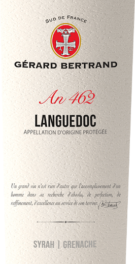 The Heritage 462 Languedoc from Gérard Bertrand appears in the glass in a deep dark red with violet reflections. The bouquet of this red wine seduces with the aromas of red and black berries, which are rounded off by licorice, gingerbread spice and a hint of garrigue. The palate reflects the nuances of the bouquet and delights with its finesse and the gentle tannins. Full-bodied, this lively cuvée goes on for a long reverberation with the accents of roasted coffee and peppery spices. Vinification of Gérard BertrandHeritage 462 Languedoc This cuvée is made from Syrah and Grenache vines. These grapes are picked by hand at their respective optimal ripening times. Then they are vinified separately to obtain the individual characteristics of the grape varieties. The grapes of the Syrah are macerated for about 15 days at low temperatures, the Grenache grapes are completely destemmed and macerated over a period of 3 weeks. After pressing and alcoholic fermentation, part of the wine is aged for 10 months in French oak barrels. Then it is blended with the other part to a cuvée and bottled after a slight fining. The Terroir Languedoc then rests for a few months in the bottle for refinement. Food recommendation for the Gérard Bertrand Languedoc Enjoy this dry red wine with grilled meats and poultry, spicy pasta, braised aubergines or aged cheese.