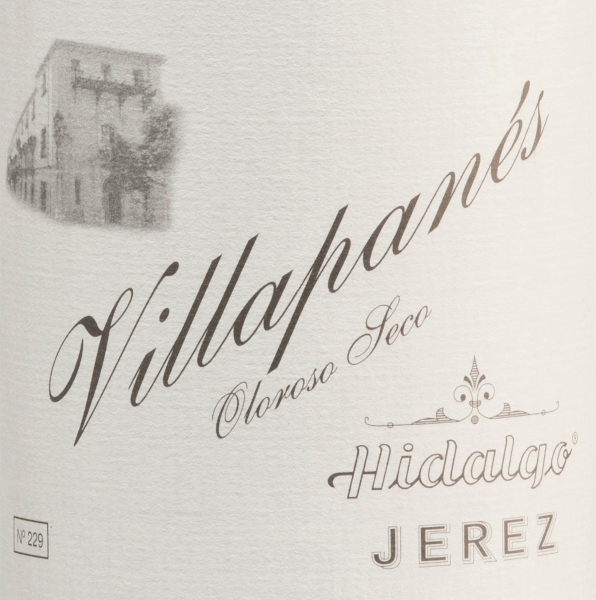 The Villapanés Oloroso Seco by Emilio Hidalgo comes from the Spanish D.O. Jerez region - a sherry that is exclusively vinified from the Palomino Fino grape variety. This wine was aged in French oak for almost 15 years.  The glass shows an appealing mahogany colour with golden brown highlights. Despite the long barrel maturity, the bouquet is still fresh and elegant with aromas of walnuts, hazelnuts and walnuts, underpinned by a fine spice. On the palate, this sherry convinces with its profound, sustainable personality and a long-lasting reverberation.  Vinification of Emilio Hidalgo Villapanés Oloroso Seco The grapes harvested by hand are destemmed, gently pressed and the must produced therefrom is fermented in a temperature-controlled manner in a stainless steel tank. This young wine is then drawn off, sprayed on and placed in American oak barrels for the first ripening. The barrels are filled only to a certain extent (maximum 85%), so that the characteristic pile (a yeast layer) can develop, which seals the wine airtight and gives it the sherry-specific aroma. After maturation, this wine is transferred to the traditional Solera system, in which sherries of the same type are aged in barrels arranged one above the other for three to ten years. The oldest wines are stored in the lower barrels (Solera), while the youngest wines are stored in the upper rows (Criaderas). The sherry intended for sale is always removed from the lower barrels. In this case, however, only a small part (a maximum of one third) is removed and the removed part is then filled up by sherry from the upper rows. The whole principle continues to the uppermost barrels, where young wine, the Mosto, is added to the sherry. Food recommendation for  the Villapané  Hidalgo Oloroso Seco This sherry from Spain is a wonderful soloist, slightly chilled. But also with strong stews (as with grandma) or spicy hard cheeses a very good choice.  Awards for  the Villapanés Oloroso Seco by Emilio Hidalgo Vinum: 18,5 points Guía Peñín: 94 points